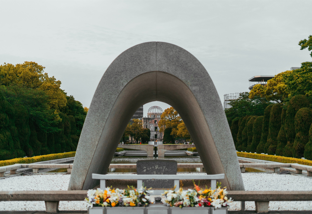 Arch over cenotaph at Hiroshima Peace Memorial Park with A-Bomb dome in distance